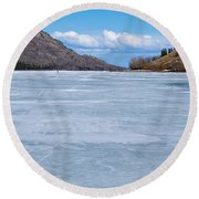 Skiing On Frozen Lake Laberge Yukon Canada Round Beach Towel