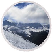 Skiing With A View Round Beach Towel by Fiona Kennard
