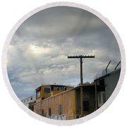 Sky Clouds And Graffiti Old Santa Fe Railyard Round Beach Towel