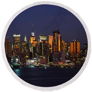 Skyscrapers Lit Up At Night In A City Round Beach Towel by Panoramic Images