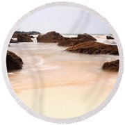 Slow Shutter Sea Around Rocks Round Beach Towel