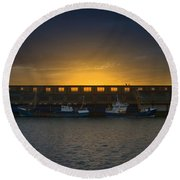Small Boat Waiting In The Harbor Of Oostende Round Beach Towel