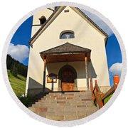 small church in Penia Round Beach Towel