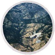 Small Plane Flying Over Mountains Round Beach Towel