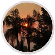 Smoke Covered Sky Sunset Thru The Palm Trees Round Beach Towel