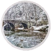 Snow Coming Down On The Wissahickon Creek Round Beach Towel