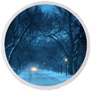 Snowy Road On A Winter Evening Round Beach Towel
