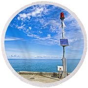 Solar-powered Light In Halls Harbour In Nova Scotia-canada Round Beach Towel