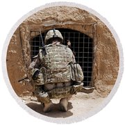 Soldier Searches A Compound Round Beach Towel by Stocktrek Images