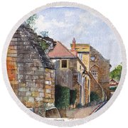 Souvigny Eclectic Architecture In A Village In Central France Round Beach Towel
