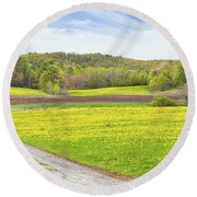 Spring Farm Landscape With Dirt Road And Dandelions Maine Round Beach Towel