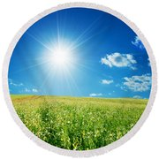 Spring Field With Flowers And Blue Sky Round Beach Towel
