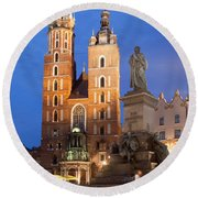 St Mary Basilica And Adam Mickiewicz Monument At Night In Krakow Round Beach Towel