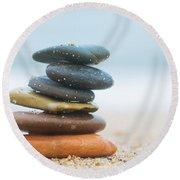Stack Of Beach Stones On Sand Round Beach Towel by Michal Bednarek