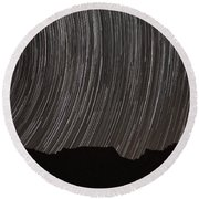 Star Trails Above A Valley Round Beach Towel by Amin Jamshidi