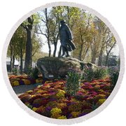 Statue And Flower Bed Across The Street From The Grand Palais Off Of Champs Elysees Round Beach Towel