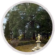 Statue And Tree Round Beach Towel