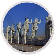 Statues On Facade Of St Peters Round Beach Towel