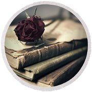 Still Life With Books And Dry Red Rose Round Beach Towel