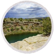 Storm Clouds Over Montezuma Well Round Beach Towel