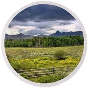 Storm Clouds Over The Rockies Round Beach Towel