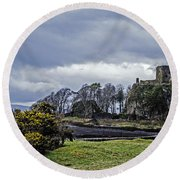 Storm Over Dunollie Round Beach Towel