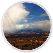 Storm Over The La Sals Round Beach Towel