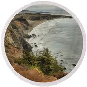 Storms Over A Rugged Coast Round Beach Towel