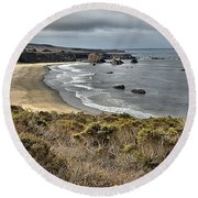 Storms Over An Unspoiled Beach Round Beach Towel