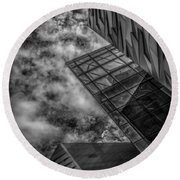 Stormy Clouds Over Modern Building Round Beach Towel