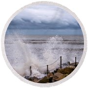 Stormy Seafront  Round Beach Towel
