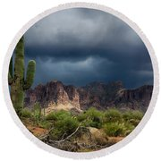 Stormy Skies Over The Superstitions Round Beach Towel
