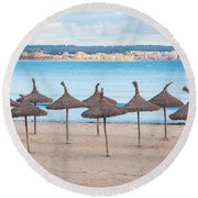 Straw Umbrellas On Empty Beach Round Beach Towel