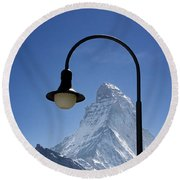 Street Lamp And Mountain Round Beach Towel by Mats Silvan