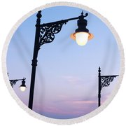 Street Lamps Over Sunset Sky Background Round Beach Towel