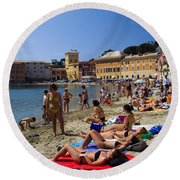 Sun Bathers In Sestri Levante In The Italian Riviera In Liguria Italy Round Beach Towel