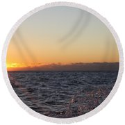 Sun Rising Through Clouds In Rough Waters Round Beach Towel