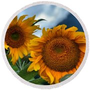 Sunflowers In The Wind Round Beach Towel