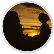 Sunrise Arches National Park With Balanced Rock Silhouetted Agai Round Beach Towel