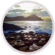 sunset at Giant's Causeway Round Beach Towel
