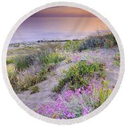 Sunset At The Beach  Flowers On The Sand Round Beach Towel