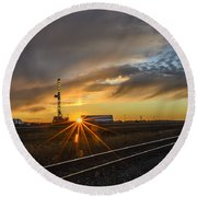 Sunset At The Edge Of Oil Rigs Round Beach Towel