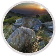 Sunset At The Windy Mountains Round Beach Towel
