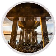 Sunset From Under The Pier Round Beach Towel