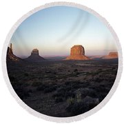 Sunset Light With Mittens And Desert In Monument Valley Arizona  Round Beach Towel