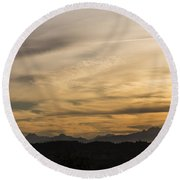Sunset On The Olympics Round Beach Towel
