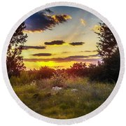Sunset Over Field Of  Flowers Round Beach Towel
