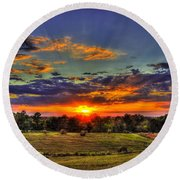Sunset Over The Hay Field Round Beach Towel