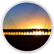 Sunset Over Tree Lined Road Round Beach Towel