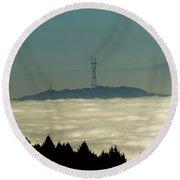 San Francisco's Sutro Tower Across The Sea Of Fog Round Beach Towel